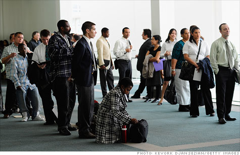 Job seekers look for employment at a career fair In Los Angeles.