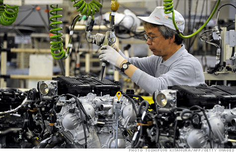 A factory worker assembles a Nissan engine at the Iwaki engine plant in Japan. The plant, which stopped operations for two months after the March 11 earthquake, didn't resume work until May.