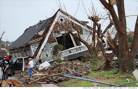 Missouri Gov. Jay Nixon took $50 million from the state budget to clean up Joplin tornado.