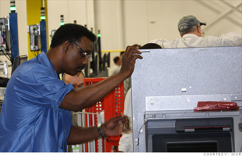 A worker building an ATM at NCR's new Columbus, Ga., plant. The machines had previously been built overseas.