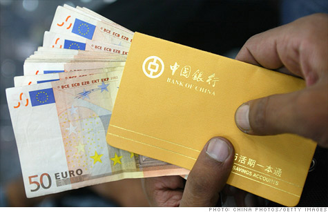 A man holds a stack of euro notes at a bank in Guangzhou of Guangdong Province, China.