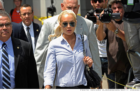 Lindsay Lohan is promoting a controversial penny auction site, Beezid, while under house arrest at her Venice Beach home.