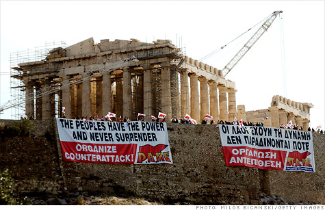The Greek government approved unpopular austerity measures Wednesday to secure another dose of emergency financial aid.