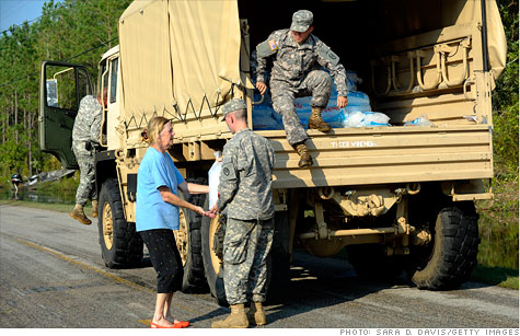 Members of the National Guard hand out bags of ice on Sunday to residents of Goose Creek Island, N.C., stranded by Hurricane Irene.
