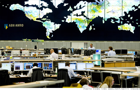 Traders in the dealing room of the ABN AMRO bank in Amsterdam, watch global transactions on August 8, 2011.