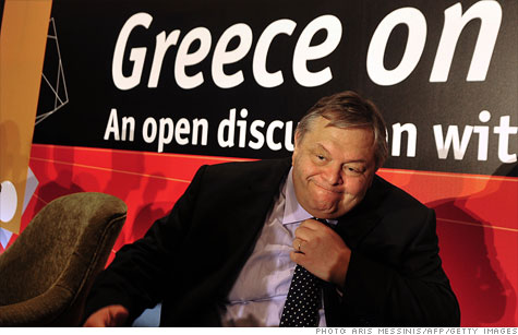 Greek Finance Minister Evangelos Venizelos adjusts his tie during an Economist conference in Vouliagmeni on Sept. 19.
