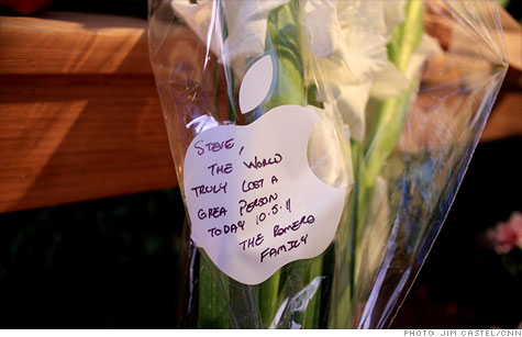 An apple-shaped note to Steve Jobs was left with flowers outside Apple's headquarters Thursday.