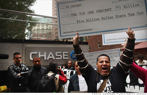 Occupy Wall Street protesters march outside a JPMorgan Chase building in downtown Manhattan. Protesters may need to team up with angry invetsors to really change anything.