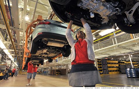 Ford Motor had its credit rating upgraded after union members ratified a new 4-year labor deal,
