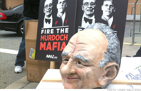 Protestors gathered outside the News Corp. annual shareholder meeting in Los Angeles on Friday.