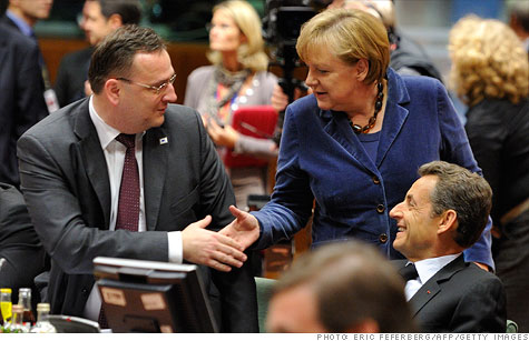 Czech Prime Minister Petr Necas shakes hands with German Chancellor Angela Merkel, as EU leaders reach an agreement to solve Europe's debt crisis.
