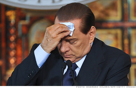 Italian Prime Minister Silvio Berlusconi is under heavy pressure to resign, as parliament narrowly passes budget reforms.