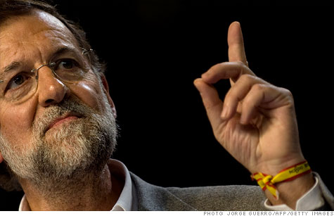 Leader of the Spanish conservative Popular Party opposition party Mariano Rajoy delivers a speech during a campaign meeting in Seville, just days ahead of November 20 general elections.