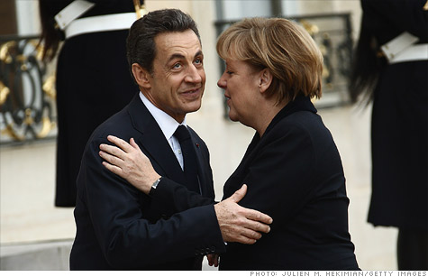 French President Nicolas Sarkozy welcomes German Chancellor Angela Merkel at Elysee Palace on December 5, 2011 in Paris, France.