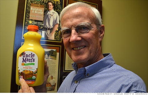 Benny McLean, production manager for Uncle Matt's Organic in Florida, holds up a bottle of his company's orange juice, which recently moved its U.S. label to the prominent front.