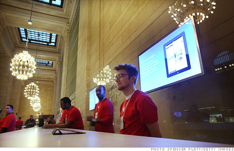 Employees at the new Apple store in Grand Center Terminal in New York. Most Apple employees work in the company's retail division.