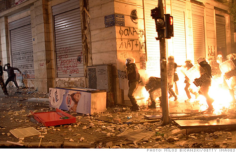 As protests rage in Athens, Greek lawmakers have approved austerity cuts that are key in order for the nation to secure additional bailout funds.