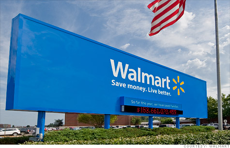 Wal-Mart's earnings were slightly higher than a year earlier, but below forecasts.