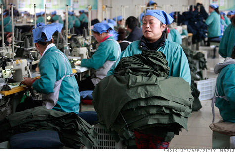 Chinese workers toiled at a textile factory in February. The Chinse government and HSBC have painted a mixed picture for manufacturing activity.