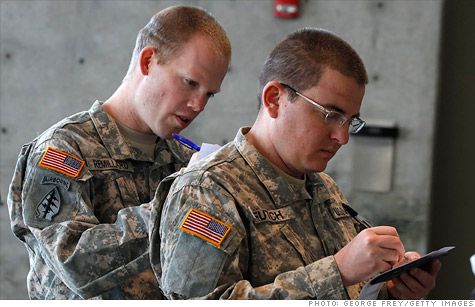 Soldiers Michael Futch and Logan Remillard registered for a job fair in Utah in November.