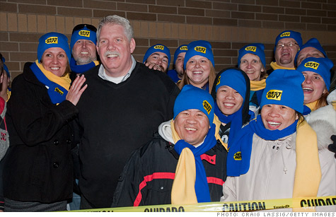 CEO Brian Dunn, seen here with Black Friday shoppers in Minnesota last year, was in an inappropriate relationship with a coworker, Best Buy said.