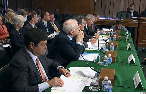 Regulators testify about JPMorgan Chase losses at a Senate Banking hearing.