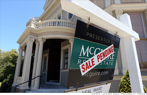 Home sales slowed slightly in May, as the housing market continues on its bumpy road to recovery.
