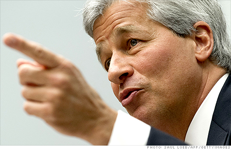 Jamie Dimon said he will reveal the size of JPMorgan's trading losses on a conference call with investors Friday morning.