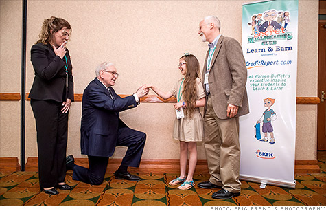 Warren Buffett makes a mock marriage proposal to 10-year old Aria  Eppinger, winner of a