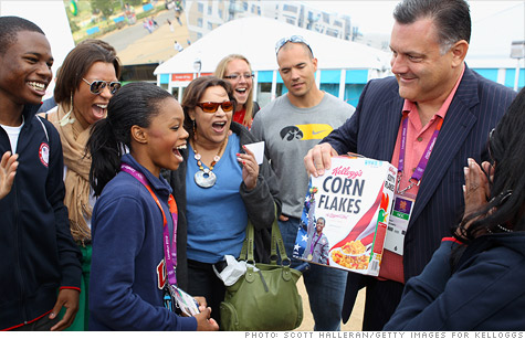 Gabby Douglas is presented with the first box of Corn Flakes with her picture on it hours after winning the gold medal in gymnastics.
