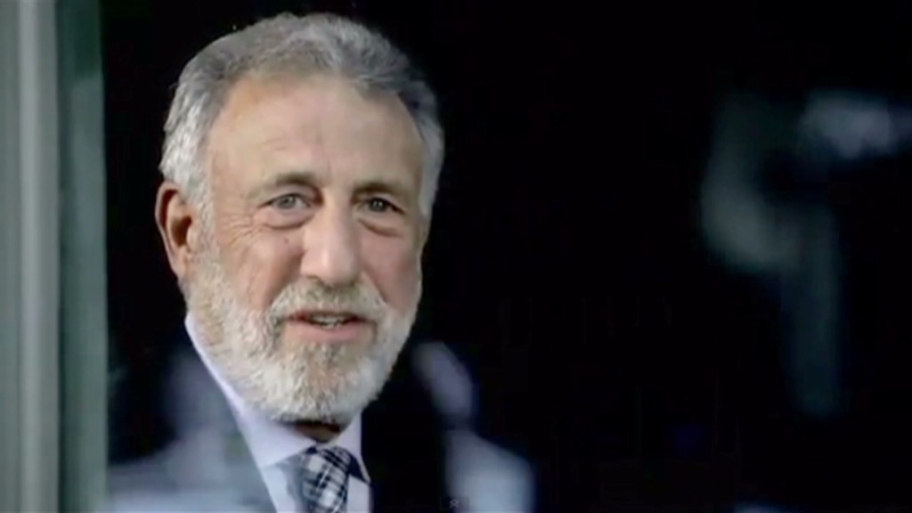 George Zimmer packs his suit and tie