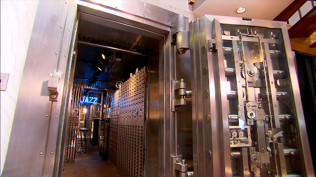 a fullystocked bar in a vault inside a bank turned