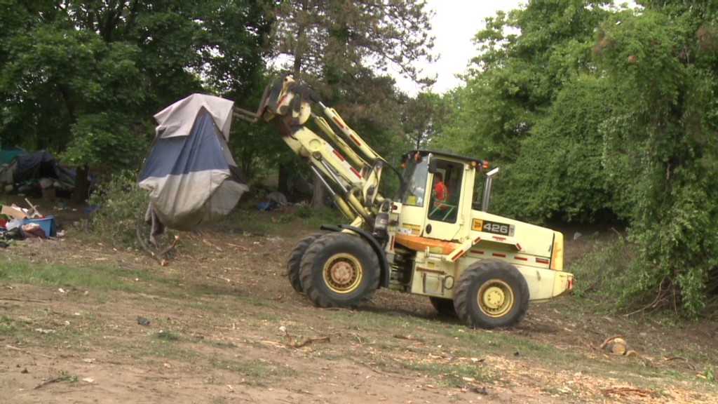 Watch a tent city get bulldozed