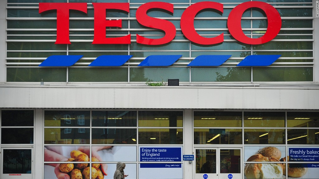 Tesco reports $408 million profit error
