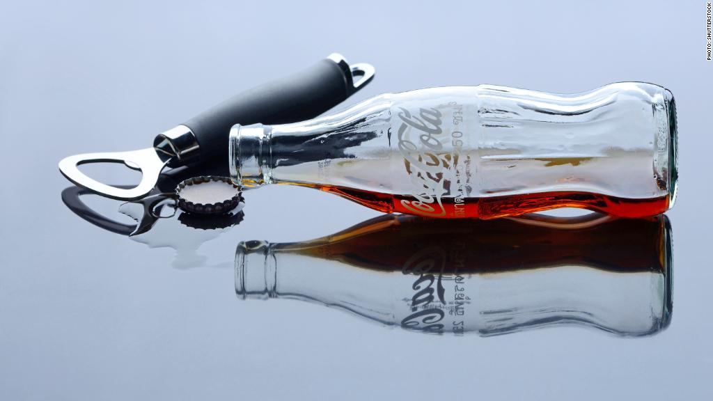coke earnings empty bottle
