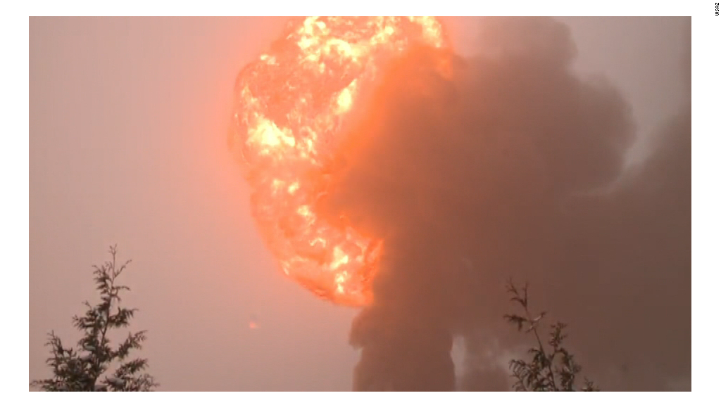 Train carrying oil derails and bursts into flames