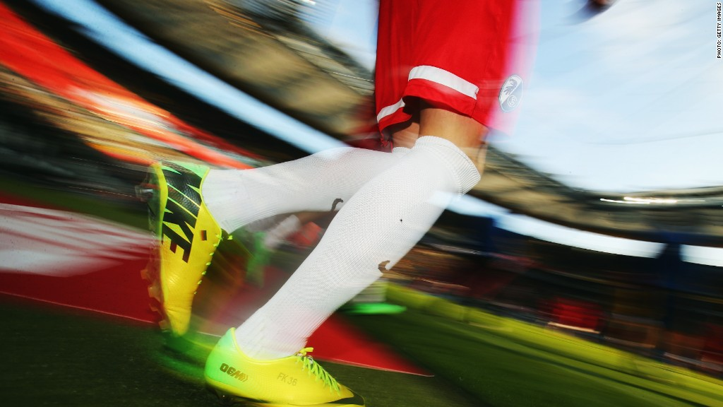 Swoosh! Nike pops despite strong dollar
