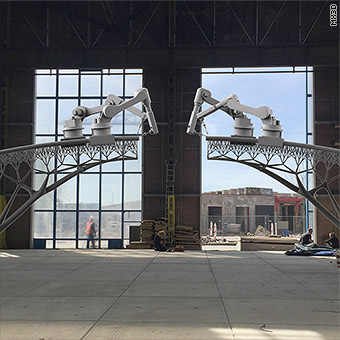 Robots to build canal bridge using 3D printing