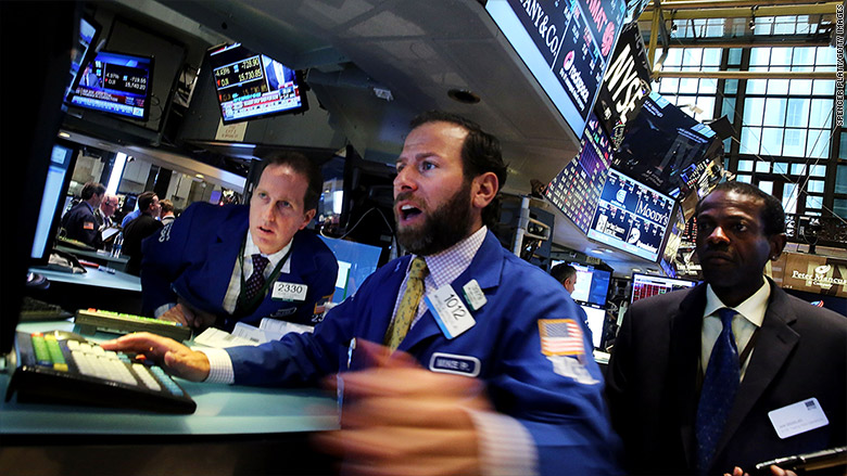 Dow dives 588 points at close, after historic 1,000-point plunge
