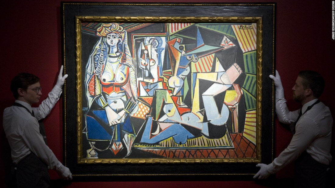 Employees of Christie's auction house hold up Spanish painter Pablo Picassos Les femmes dAlger (Version O) during a press preview in London on April 10, 2015. Les femmes dAlger (Version O), a vibrant cubist work last auctioned in 1997 when it nearly tripled the expected price, is estimated to fetch about 140 million USD at auction in New York in May, by far the highest price ever for a work of art on the auction block. AFP PHOTO / JUSTIN TALLIS RESTRICTED TO EDITORIAL USE, MANDATORY MENTION OF THE ARTIST UPON PUBLICATION, TO ILLUSTRATE THE EVENT AS SPECIFIED IN THE CAPTION (Photo credit should read JUSTIN TALLIS/AFP/Getty Images)