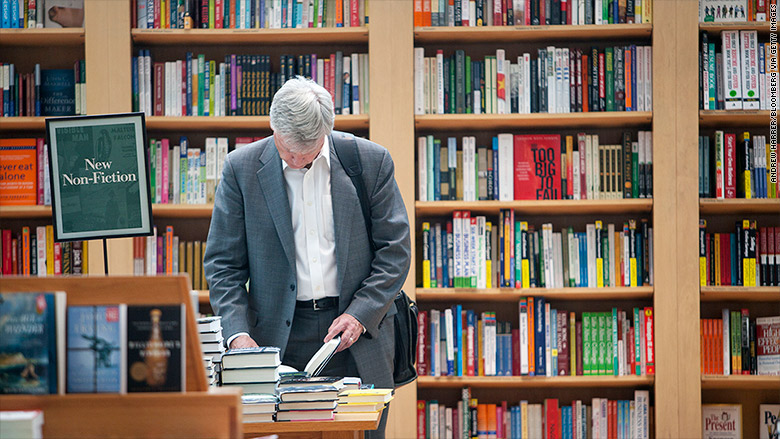 man browsing books bookstore