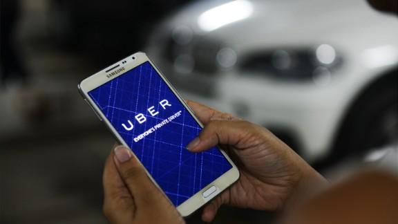 Uber hits 2 billion rides