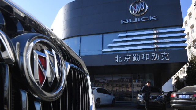 A Woman Stands Outside Buick Showroom In Beijing On December 15 2016