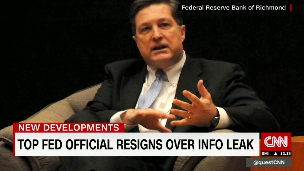 Top Fed official resigns over info leak