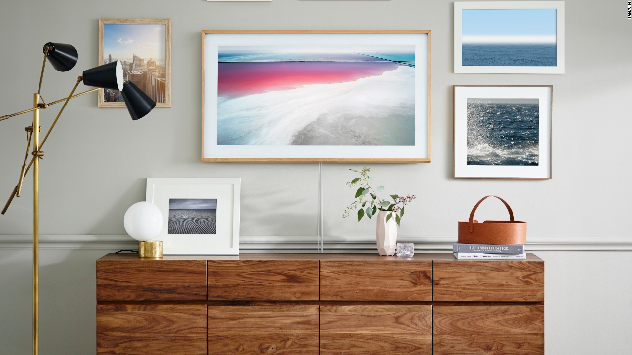Samsungu0027s new Frame TV is designed to look like artwork on the wall when you arenu0027t watching it. & This TV doubles as a work of art - Video - Technology