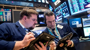 Dow drops 459 points as Amazon tumbles, trade war fears rise