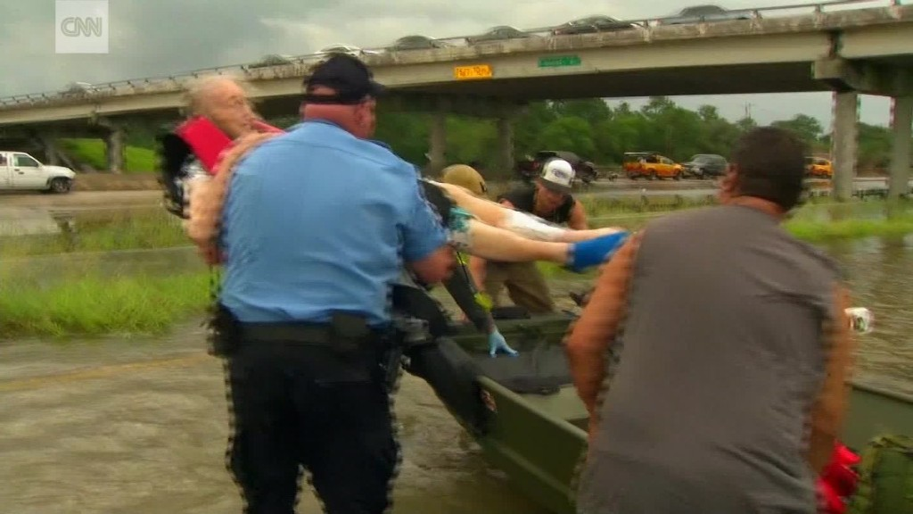 See dramatic rescues as Harvey flooding spreads
