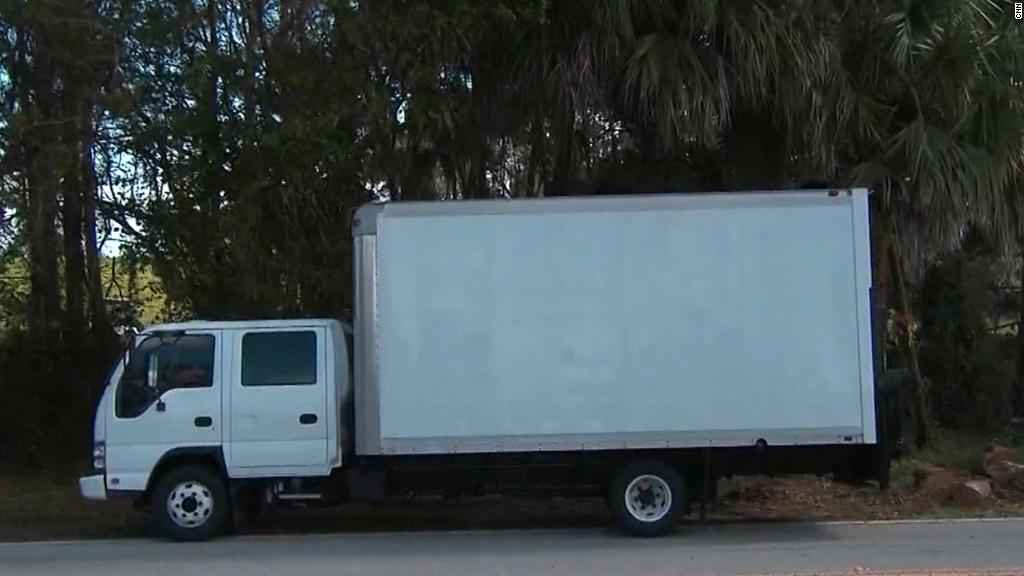 Truck blocks camera from showing Trump golfing