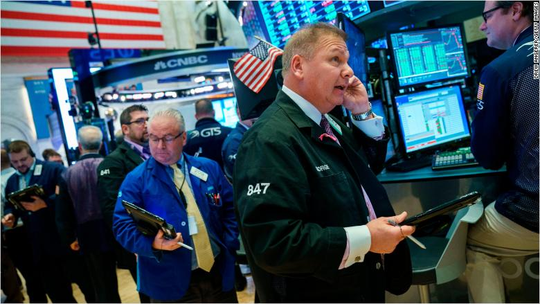 Premarket: Stock futures dip; Big earnings day; South Africa watch