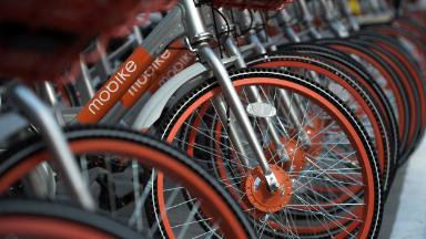 China's bike-sharing competition heats up with Mobike sale